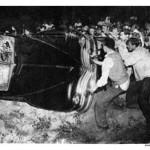Rioters overturn a car at Peekskill
