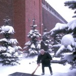 Worker Sweeping Snow From Stone Marking Josef Stalin's Grave