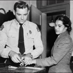Rosa Parks being fingerprinted in 1955