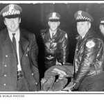 The murderous Chicago Police Officers cannot contain their glee as they carry the body of Fred Hampton