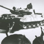 Cheering crowds as Soviet T-62 battle tank withdraws from Afghanistan